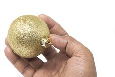 Free Hand Holding A Beautiful Golden Christmas Ball Royalty Free Stock Images - 18164939
