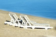 Free Two Sundecks On The Beach, Facing The Sea Stock Images - 18168734