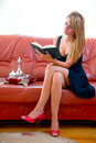 Free Woman Reading A Book On The Sofa Stock Images - 18179354