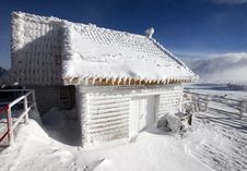 Wooden Cottage Covered With Snow Royalty Free Stock Photo