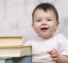 The Small Child With Books Royalty Free Stock Images
