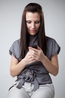 Woman Using A Mobile Phone Stock Photography