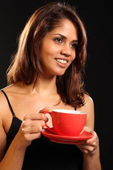 Red Tea Cup And Saucer With Beautiful Happy Woman Stock Images