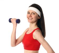 Free Happy Young Woman Exercising With A Dumbbell Stock Photo - 18175740