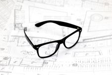 Free Black Glasses On The Architectural Blueprints Royalty Free Stock Photo - 18176085