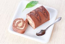 Free Swiss Roll With Milk Cream And A Green Leaf Royalty Free Stock Photos - 18177318