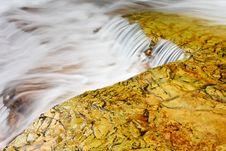 Cascade Over Golden Rocks Stock Photos