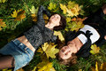 Free Two Happy Young Woman On Grass And Yellow Leaves Stock Photo - 18181170