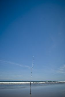 Free Fishing Rod At The Sand Of The Beach Stock Photography - 18180512