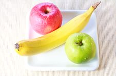 Banana, Green And Red Apples On Plate Stock Photo