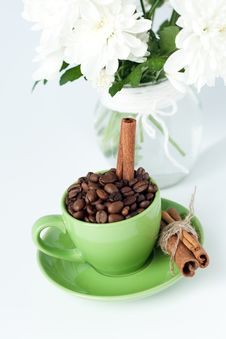 Free Coffee Beans And Cinnamon Stick In A Green Cup Royalty Free Stock Images - 18181739