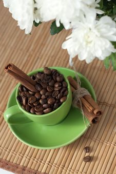 Free Coffee Beans In A Green Cup Stock Image - 18181841