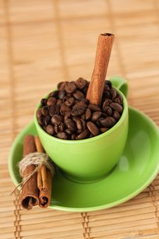 Free Coffee Beans And Cinnamon Stick In A Cup Stock Photography - 18181932