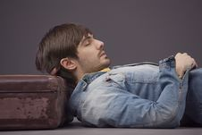 Free Man Relaxing On Suitcase Royalty Free Stock Photos - 18184218