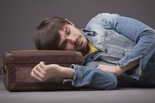 Free Man Sleeping On Suitcase Stock Photography - 18184242