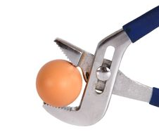 Free Egg Clamped In A Vise Pipe Fittings Key Royalty Free Stock Image - 18184586
