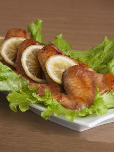 Fried Chicken Wings With Lettuce Royalty Free Stock Photography