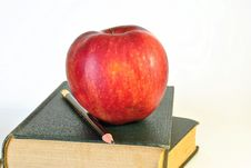 Old Books With An Apple Stock Photography