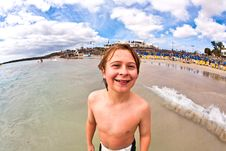 Free Boy Has Fun At The Beach Royalty Free Stock Images - 18189809