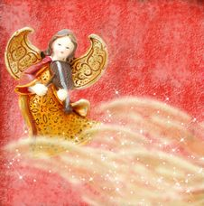 Angel With Violin On Red Background Stock Photos