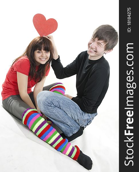 Cheerful couple with red heart