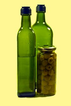 Free Green Bottles And Olives Royalty Free Stock Photo - 18190515
