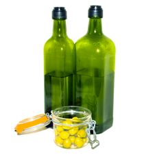 Green Bottles And Olives Stock Photography