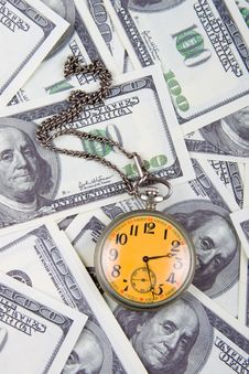 Free Pocket Watch On A Stack Of Dollars Stock Images - 18195094