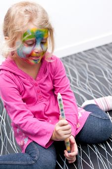 Free Child Having Her Face Painted Royalty Free Stock Image - 18196646