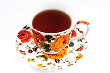 Classic Tea Cup With Red And Orange Flowers Stock Photography