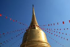 Free Golden Pagoda With Red Flag Of Buddhism Spell Royalty Free Stock Photography - 18198447