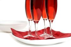 Free Four Glasses Of Rose Champagne On A Red Napkin Isolated On White Royalty Free Stock Photo - 1823365