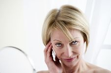 Free Mature Woman Making Up Stock Photo - 18201790