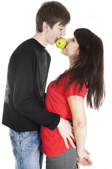 Free Cheerful Young Couple Eats One Apple Royalty Free Stock Image - 18204086