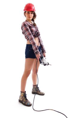 Free Girl Standing With Drill Royalty Free Stock Photography - 18204827