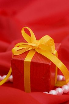 Free Box With A Gift On A Red Fabric Royalty Free Stock Photo - 18205235