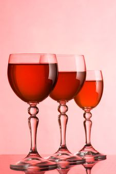 Free Wine Glasses With Wine On A Pink Background Royalty Free Stock Photos - 18205378