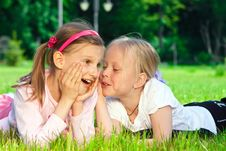 Free Two Pretty Young Girls On A Grass Royalty Free Stock Photos - 18205998