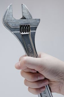 Pliers In A Child S Hand Royalty Free Stock Photos