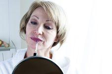 Free Woman Applying Lipstick Stock Photos - 18207183