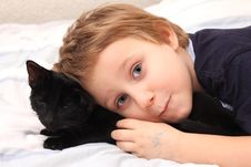 Free Littel Boy With A Cat Royalty Free Stock Image - 18208436