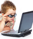 Free A Cute Boy Is Typing On A Laptop Stock Images - 18215174