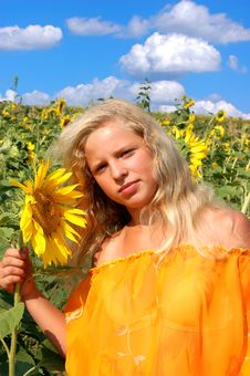 Free The Girl And Sunflowers Stock Image - 18210331