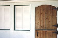 Free Wooden Over/under Door And White Shutters Royalty Free Stock Photos - 18212488