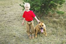Little Smudgy Boy With A Dangerous Dog Royalty Free Stock Image
