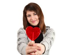 Free Girl With A Heart-shaped Candy Stock Photography - 18213272
