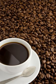 Cup Of Coffee And Beans Stock Photos