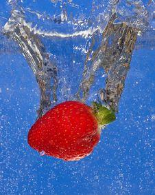 Free Strawberry Splash On Blue Background Stock Image - 18214591