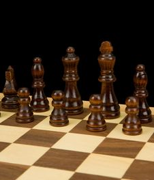 Free Chess Piece On Board Isolated On Black Stock Images - 18214914