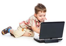 Free A Cute Boy Is Typing On A Laptop Stock Image - 18215171
